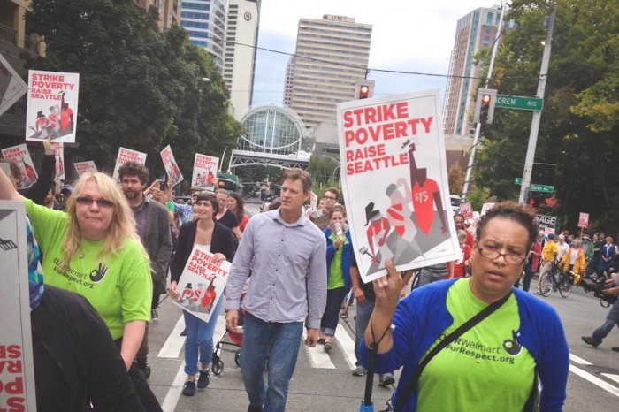 Monica Smith (right) marches in support of a $15 minimum wage in Seattle earlier this year. (Photo by Reagan Jackson)