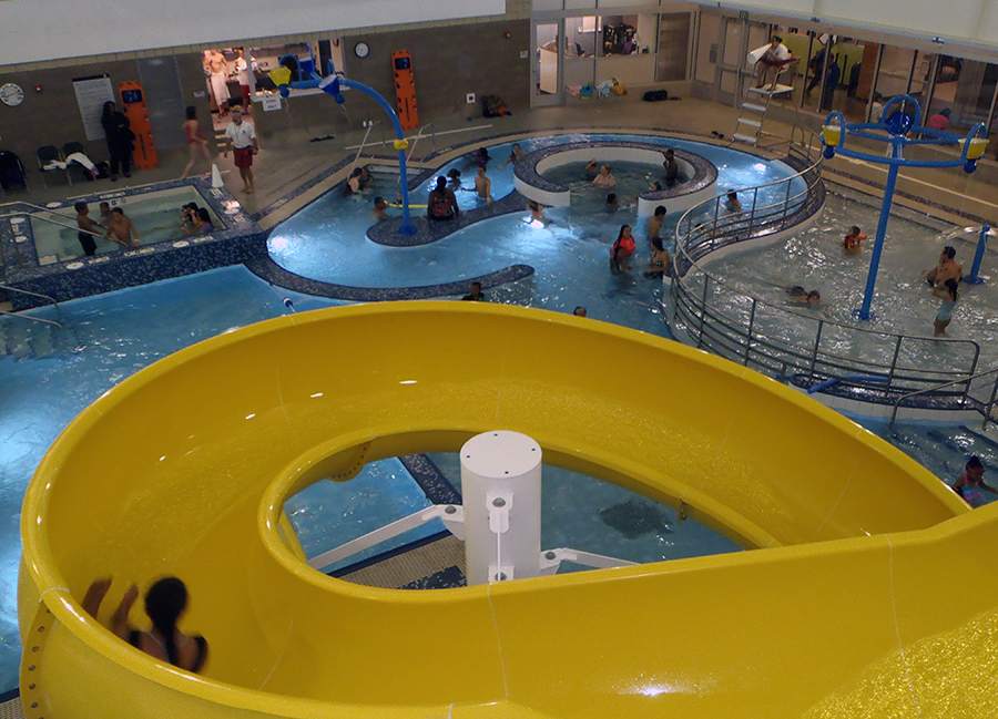 The new pool at the Rainier Beach Community Center features indoor water slides. (Photo thanks to the City of Seattle)
