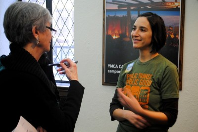 Rebecca Saldaña, Deputy Director at Seattle think tank Puget Sound Sage, connects with a community member at a public meeting about the Transportation Benefit District, last month.