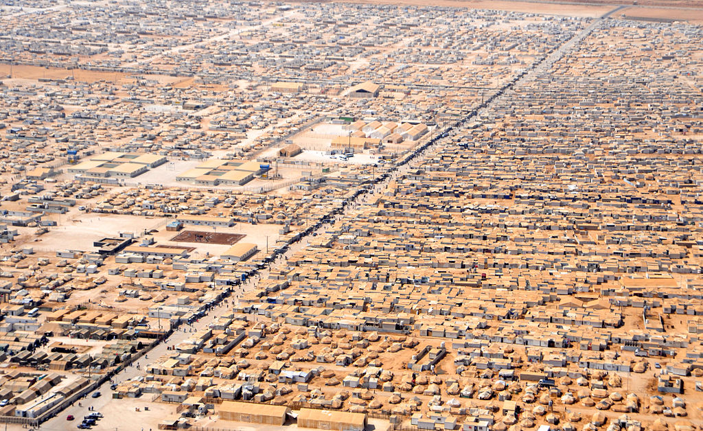 A close-up view of the Za'atri camp for Syrian refugees as seen on July 18, 2013, from a helicopter carrying U.S. Secretary of State John Kerry and Jordanian Foreign Minister Nasser Judeh. (Photo by US State Department via Wikimedia Commons)