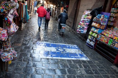 An Israeli flag painted on the ground on a busy street in Damascus symbolizes the Syrian government's longstanding use of enmity with Israel as a nationalist rallying point. (Photo by Alex Stonehill)