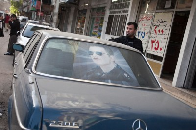 Prior to the outbreak of civil war in 2011, cars in Syria were often decorated with portraits of members of the Assad family, including Bassel, the president's deceased brother, seen here. (Photo by Alex Stonehill)