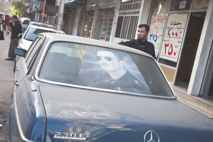 Prior to the outbreak of civil war in 2011, cars in Syria were often decorated with portraits of President Bashar al-Assad and other members of the Assad family. (Photo by Alex Stonehill)