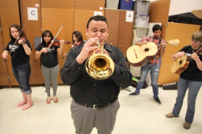 Ramon Rivera learned Mariachi music from his parents growing near Los Angeles and was recruited to run the Mariachi Huenachi program at Wenatchee High School 8 years ago. (Photo by Alex Stonehill)