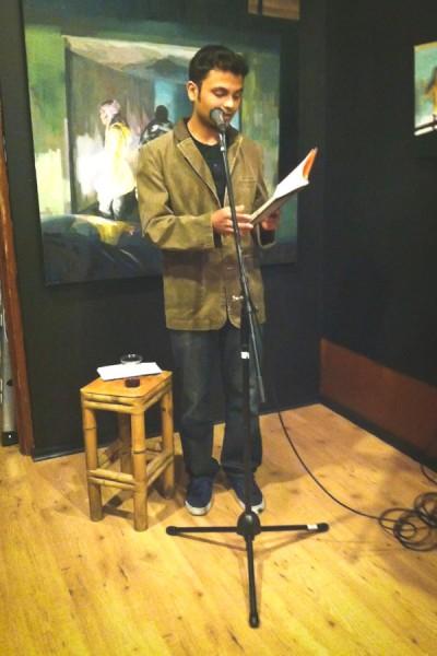 Ahmed reading unpublished works at the APRIL Festival in Seattle. (Photo courtesy Frances Dinger)