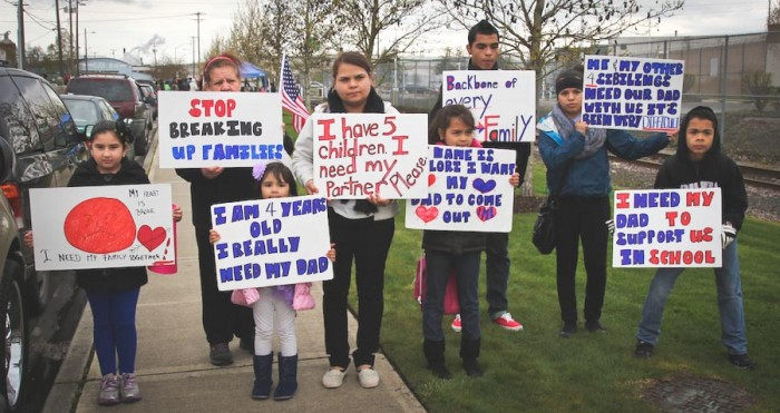 Family of detainee hold signs outside NW Detention Center Saturday