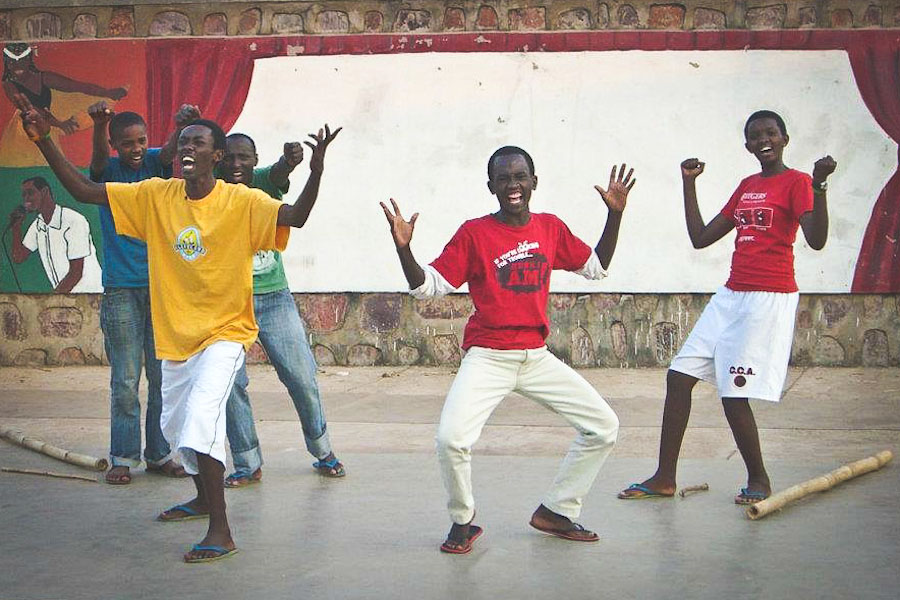 Students Mandela, Emanuel, Vladamir, Maxim and Jacky playing the Villagers in Making Peace in Old Village, August 2012. (Photo by Lea Wulferth)