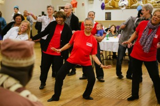 Members of the Central Area Senior Center Sliders Dance Group learn some West African moves at the November World Dance Party. (The World Dance Party held at the Filipino Community Center in November. (Photo by Steven Zhang)