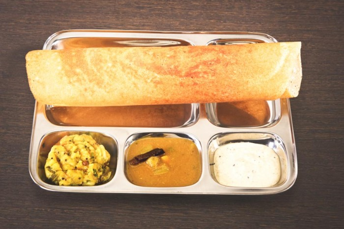 Dosa — a thin pancake made from rice and lentil batter pancake, usually filled with something tasty. (Photo from Shutterstock)