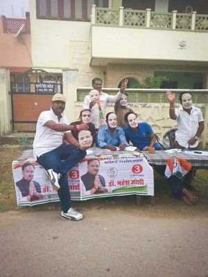 Supporters of the BJP campaign wearing masks of Narendra Modi, who is projected to be India's next Prime Minister.