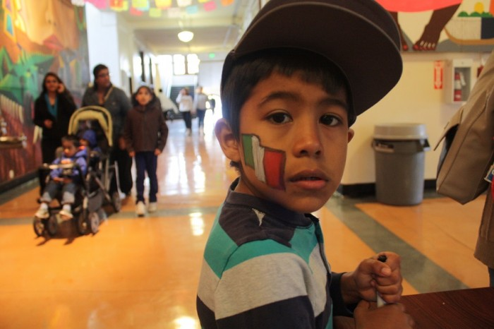 Chistopher Rojas, 6, shows the Mexican flag painted on his cheek during Cinco de Mayo at El Centro de la Raza. Passing on tradition to a new generation was an important aspect of this year's celebration.