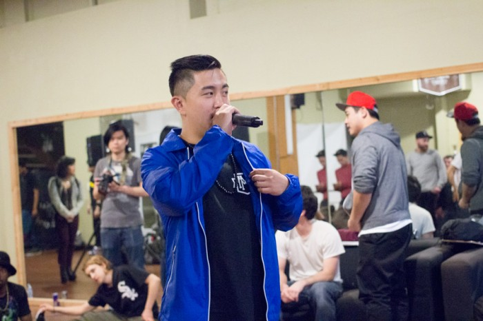 Local B-Boy event organizer Michael Huang gets the crowd pumped for the next match-up. (Photo by Austin Williams)