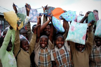 Girls at an orphanage outside of Nakuru, Kenya, celebrate the arrival of their menstrual kits made by the Days for Girls Ocala Florida Chapter. (Photo courtesy Days for Girls)