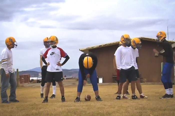"Exchange students try their hands at American football (with mixed results) in a still from ""Welcome to Unity"""