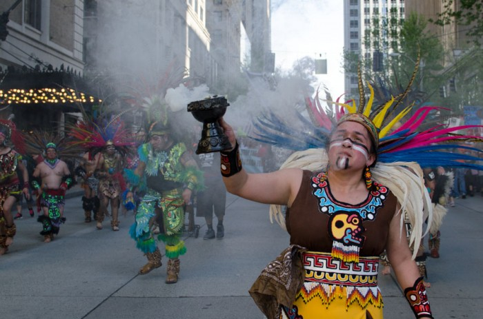 A group of Aztec dancers from Danza Ce Atl Tonalli led the march in colorful costumes burning incense. (Photo by Seth Halleran)