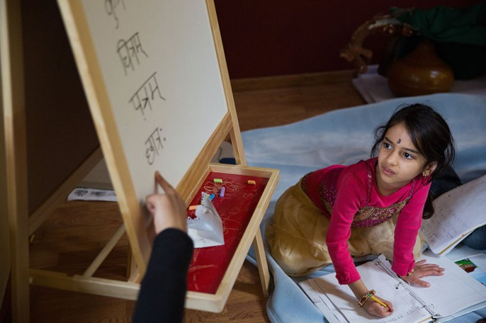 Sahana Samrat, 5, right, pays close attention to the written Sanskrit words on a whiteboard taught by Sowmya Joisa, left, at a children's Sanskrit language class, in Newcastle, on Saturday, May 10, 2014.  (Photograph by MARCUS YAM/The Seattle Times)