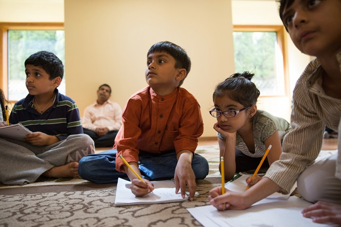 Praneel Ankalkoti, 8, from left, Koustub Grama, 6, Gargi Basavapatna, 6, and Akhil Samrat, 8, attend a children's Sanskrit language class taught by Sowmya Joisa, not pictured, in Newcastle, on Saturday, May 10, 2014.  (Photograph by MARCUS YAM/The Seattle Times)