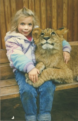 The author buddies up to a lion at the Berlin Zoo at age 5. Sedating animals for photo ops was common in Europe and Russia in the '80s. (Photo courtesy Tess Martin)