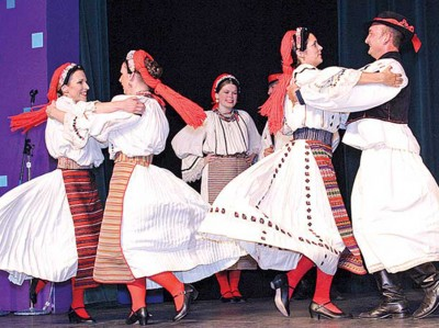 Anacortes-based group, Vela Luka Croatian Dance Ensemble, are a regular act at Folklife. Here, they perform at the annual Spring Festa in Skagit County, another one of their regular annual gigs. (Photo from www.goskagit.com)