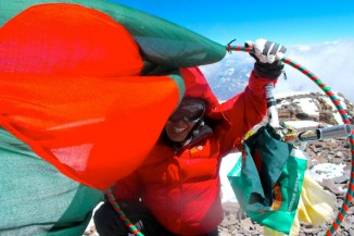 Wasfia Nazreen on the summit of Aconcagua, highest point outside Asia, with her hula hoop and Bangladeshi flag. (Photo by Jamie McGuinness)