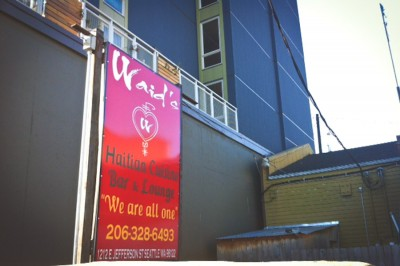 Waid's Restaurant and Lounge, in the shadow of the new Jefferson Apartment building next door. (Photo by Alex Stonehill)