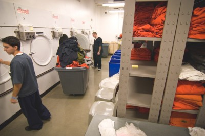 Detainees work in the laundry at the Northwest Detention Center. Hunger strikers complained that they're paid as little as $1/day for these jobs. (Photo by Alex Stonehill)
