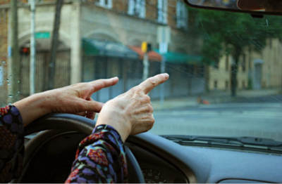 (Driver focusing on directions and attentiveness. Photo courtesy of Leslie Feinberg. bit.ly/1mzahOK)