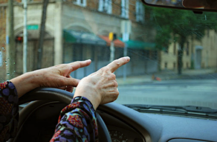 Driver focusing on directions and attentiveness. (Photo from Flickr by Leslie Feinberg)