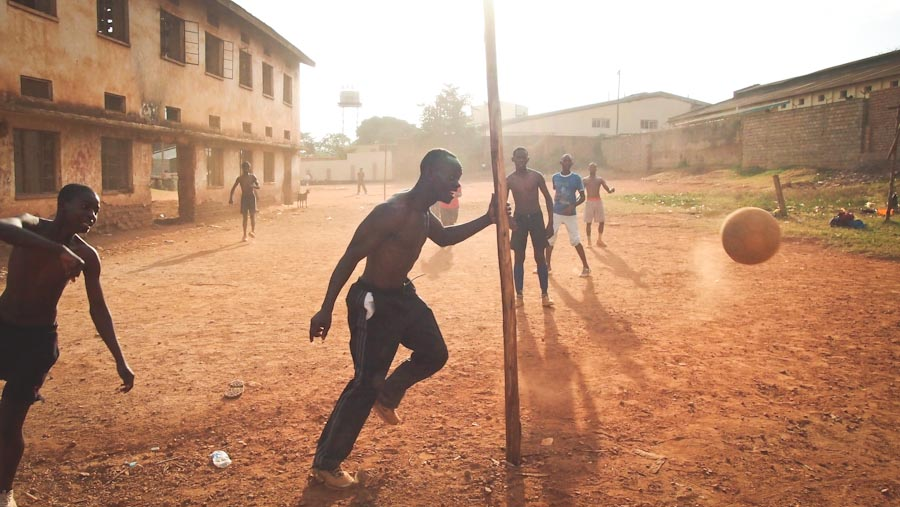 Young men play soccer in Uganda, which now has one of the world's harshest anti-homosexuality laws. (Photo by Scott Macklin)