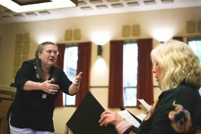 Maija Riekstins leads choir practice at the Latvian Evangelical Lutheran Church of Seattle. (Photo by Walker Orenstein)