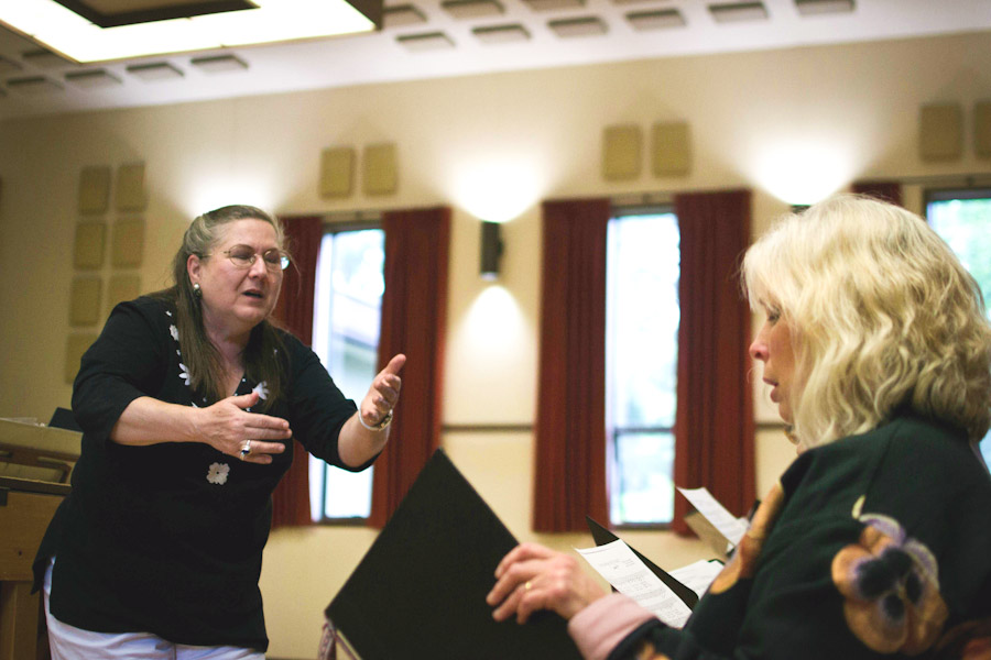 Maija Riekstins leads choir practice at the Latvian Evangelical Lutheran Church of Seattle. (Photo by Walker Orenstein)