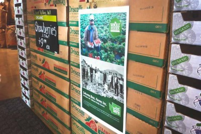 A display at the Whole Foods in South Lake Union advertises berries sourced from Sakuma Bros. Farms. The Skagit County farm will pay out a $850,000 settlement to berry pickers it abused last season. (Photo by Alex Stonehill)