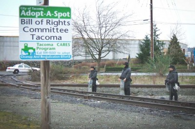 Tacoma Police at the Bill of Rights Defense Comittee's Adopt-a-spot across from the Northwest Detention Center, during a demonstration in 2009. (Photo courtesy Tim Smith)
