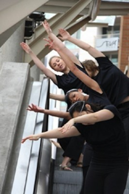 Dancers perform choreographed work on an escalator in the Whole Foods Market from last years Art on the Fly two-day event. (Photo courtesy of Wendy Simons from the Seattle International Dance Festival website.)