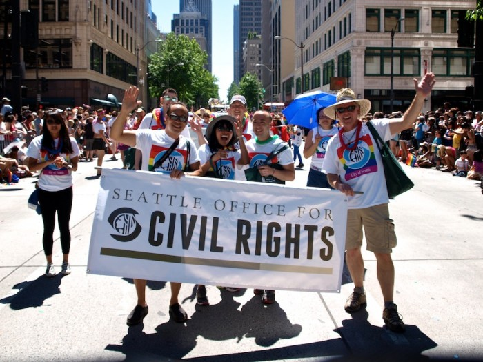 The Seattle Office of Civil Rights marches in the 2013 Pride Parade, which drew over 50,000 people. What began as a radical march in 1974 has become a mainstream, citywide event. (Photo courtesy Seattle Pride)
