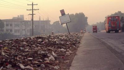Road of Bangladesh, no trash can seen.
