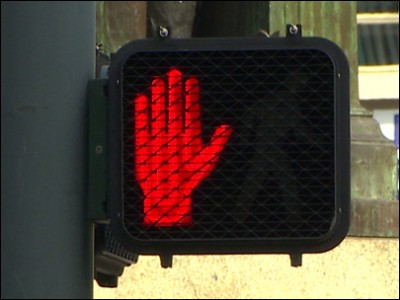 A Signal saying 'Stop' which is found in every next road in Seattle.