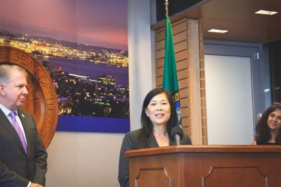Seattle's new Office of Immigrant and Refugee Affairs Director Cuc Vu (center) flanked by Mayor Ed Murray and outgoing Interim Director Aaliyah Gupta. (Photo by Kamna Shastri)