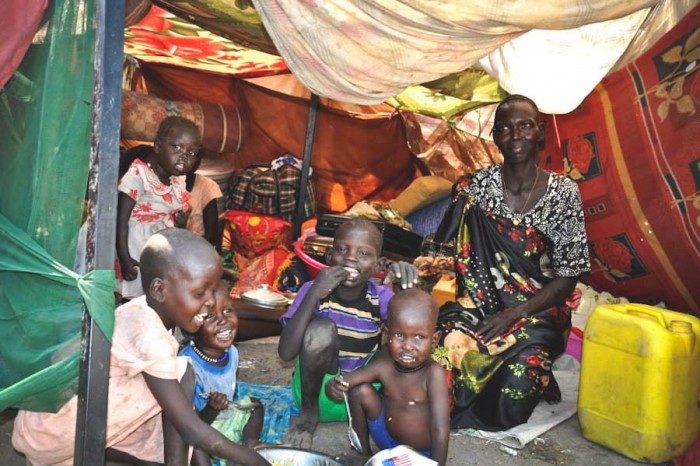 A family in a makeshift shelter at a UN compound in South Sudan. Over a million people have been displaced by the conflict. (Photo via OCHA)