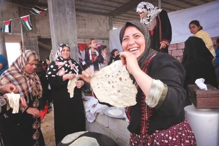 Women making bread at a celebration in Gaza. (Photo by Karin Huster)