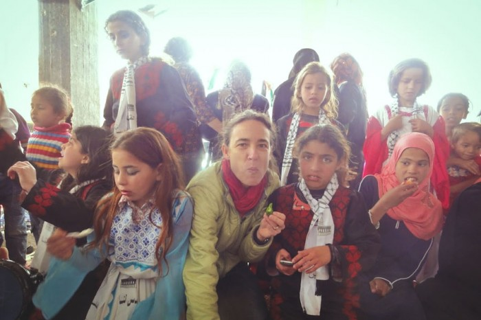 The author with children at a celebration in Gaza. (Photo by Karin Huster)