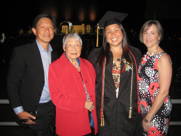 Catherine with her family on her graduation.
