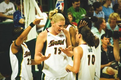 Australian superstar Lauren Jackson (center) discusses strategy with Sue Bird during a 2006 Seattle Storm game. (Photo from Wikipedia)