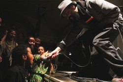Gabriel Teodros shares the mic with a young fan. (Photo by Aida Solomon)