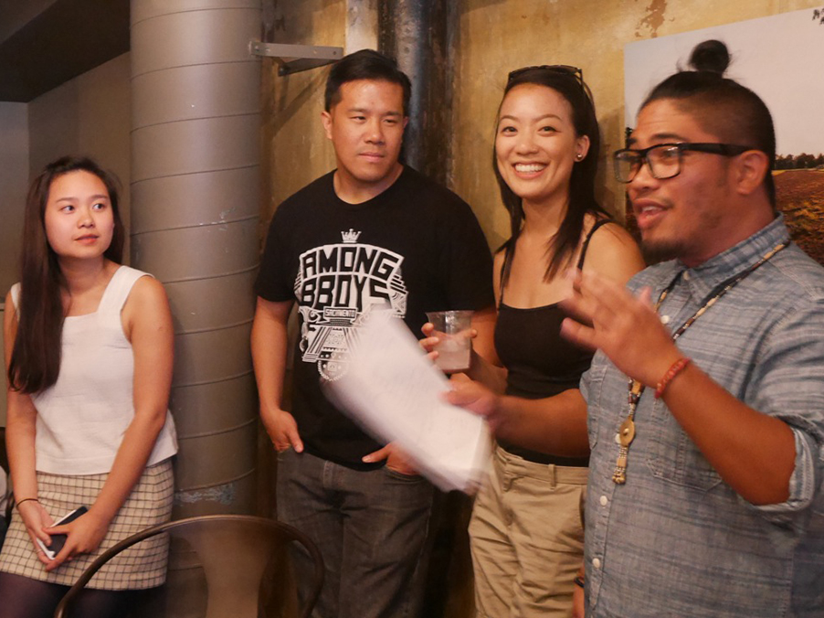 API Flying Bookshelf organizers gather a crowd of about a couple dozen at their July 17 launch party at Eastern Cafe. From left to right, co-curators Minh Nguyen and Chris Woon, and co-founders Sabrina Chen and Derek Dizon. (Photo by Tuyen Than)