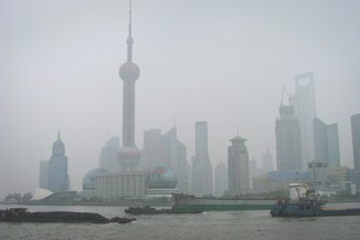 Shanghai, China shrouded in smog. Overall China emits 6.2 metric tons of CO2 per year. (Photo from Wikipedia)