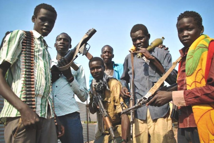 Young Sudanese men armed by the Nuer White Army, an ethnic militia fighting on behalf of former Vice President Riek Machar. (Photo by Jacey Fortin / International Business Times)