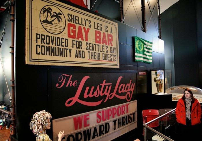The iconic sign from 'Shelly's Leg', Seattle's first disco and openly gay bar, hangs at the Museum of History and Industry. (Photo courtesy Howard Giske, MOHAI Seattle).