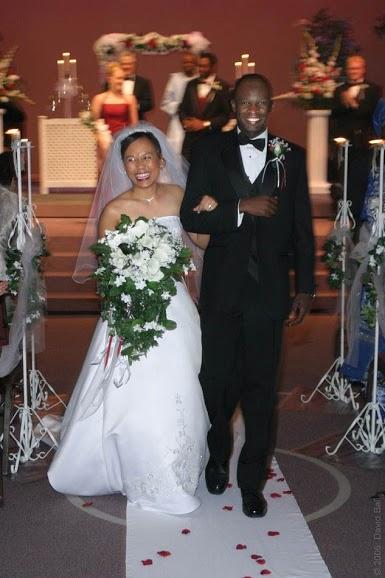 A Filipina bride and Nigerian groom walk down the aisle. Photo Credits - David Ball