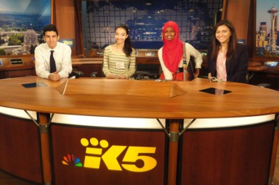 Participants in the Muslim Youth Leadership Program pose for a photo behind the KING 5 news desk. (Photo courtesy CAIR-WA)